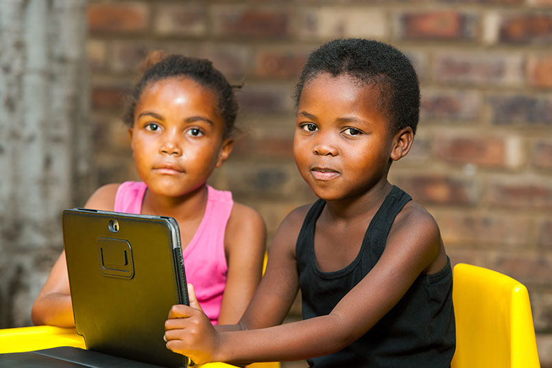 Two girls looking at a tablet computer